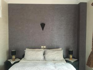 A bed or beds in a room at Marina Apartment Agadir