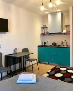 A kitchen or kitchenette at GoodAura by Room 308