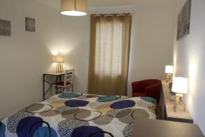 A bed or beds in a room at gîte Audeline