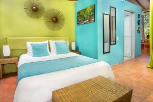 A bed or beds in a room at Tico Tico Villas - Adult Only