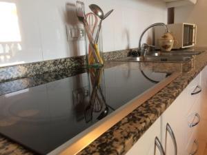 A kitchen or kitchenette at Apartamentos Playa Torrenostra