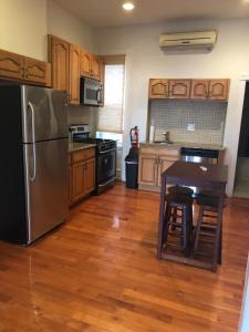 A kitchen or kitchenette at 1216 Suites 2F