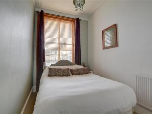 A bed or beds in a room at Apartment Med Hove