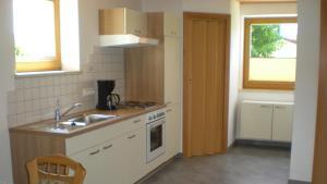 A kitchen or kitchenette at Ferienwohnung Sabine