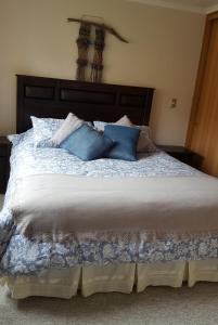 Cama o camas de una habitación en Departamento en Pucon