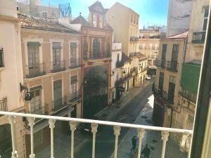 A balcony or terrace at Homely Málaga Loft Gaona Centro