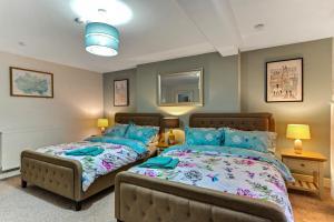 Ein Bett oder Betten in einem Zimmer der Unterkunft Crawford Square Apartment
