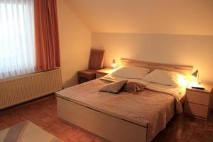 Postelja oz. postelje v sobi nastanitve Apartments Koblar