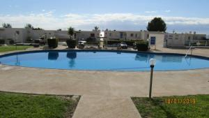 The swimming pool at or near Coral Bay Village C23