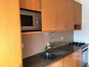 A kitchen or kitchenette at Apartamento do Parque