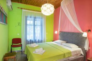 Ένα ή περισσότερα κρεβάτια σε δωμάτιο στο Helena Apartments & Villas