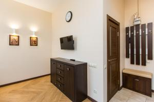 A television and/or entertainment center at Probably The Best Apartment in Lviv