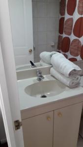 A bathroom at Monjitas Apartments