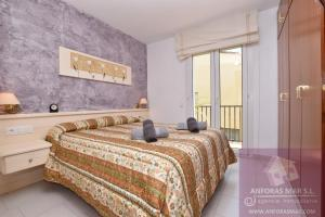A bed or beds in a room at Llaveria