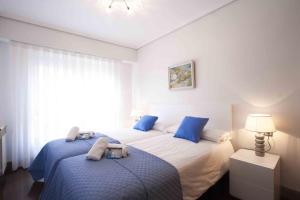 Cama o camas de una habitación en The Rentals Collection | Boutique