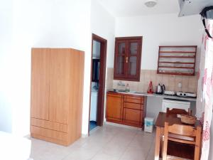 A kitchen or kitchenette at Andreas Studios