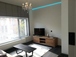 A television and/or entertainment center at Huis van Vletingen Apartment