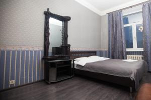 A bed or beds in a room at Kvart-Hotel Promenade