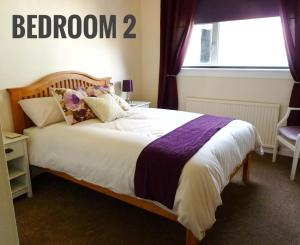 A bed or beds in a room at 154 Lochalsh Road