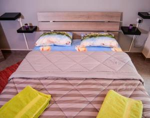 A bed or beds in a room at Aphroditi Apartment