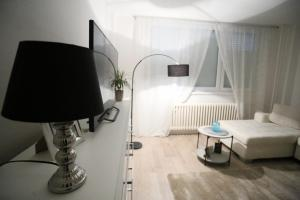 A television and/or entertainment center at Apartman City Lux