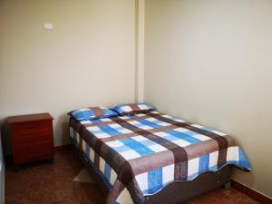 A bed or beds in a room at Canela's Apart