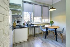 A kitchen or kitchenette at Opera Apartments