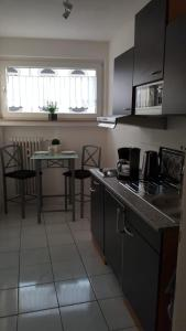 A kitchen or kitchenette at Apartment Helios