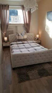 A bed or beds in a room at Apartment Helios