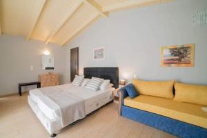 Ένα ή περισσότερα κρεβάτια σε δωμάτιο στο Τσολάκης Διαμερίσματα