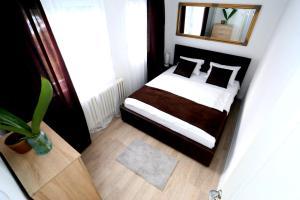 Cama o camas de una habitación en Apartman City Lux