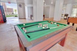 A pool table at Highly Desired Travel Condo Comfy King Bed