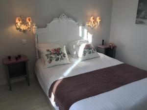 Un ou plusieurs lits dans un hébergement de l'établissement La clé des Champs