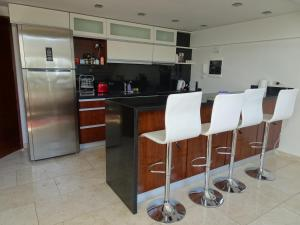 A kitchen or kitchenette at Espectacular Loft con Piscina