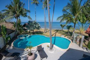 A view of the pool at Malee Beach Villas or nearby