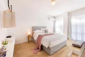 A bed or beds in a room at Maryflower Premium Apartments Piraeus