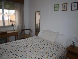 A bed or beds in a room at Home