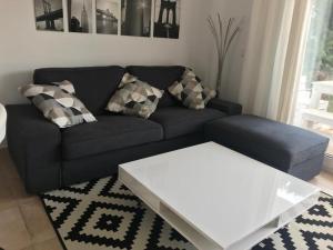 A seating area at Torres de Cala Pi