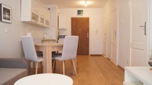 A kitchen or kitchenette at Akwamaryn apartment