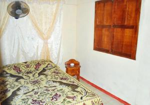 A bed or beds in a room at Casa Yoandis y Yuleidy CASILDA