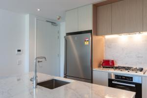 A kitchen or kitchenette at Luxury Apartment / / Moments to Lane Cove Village