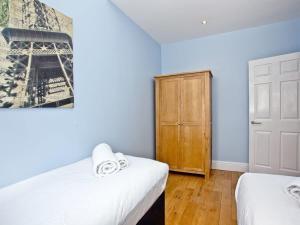 Ein Bett oder Betten in einem Zimmer der Unterkunft Cathedral View Apartment