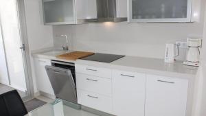 A kitchen or kitchenette at Res. El Mirador - Calle Txacolina - Punta Prima - Torrevieja