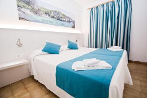 Cama o camas de una habitación en Siesta Mar Apartamentos