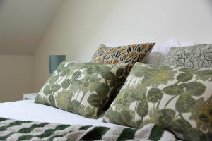 A bed or beds in a room at Green House / Casa Verde