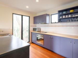 A kitchen or kitchenette at Straddie Beach House 2