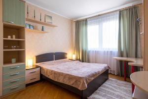 A bed or beds in a room at Moskva4you on Gerasima Kurina