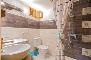 Ένα μπάνιο στο Akrathos Houses