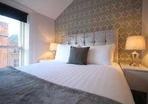 A bed or beds in a room at Trinity Apartments Temple Bar by theKeyCollections