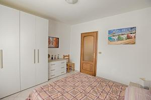 A bed or beds in a room at Apartment Alpina